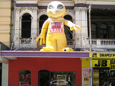 Inflatable Alien Land on Business Awning Sale Event